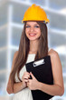 Attractive architect with blue eyes and yellow helmet