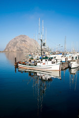 Morro Rock and fishing boats in Morro Bay, California, USA