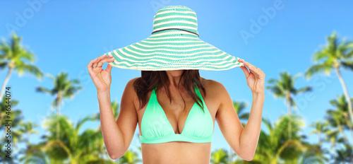 Beautiful woman in bikini and a hat.