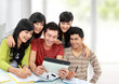 Friendly group of students using tablet pc