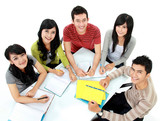 Group of happy college students studying together