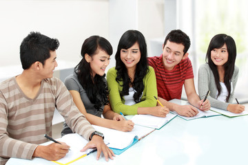 Group of asian happy college students studying together