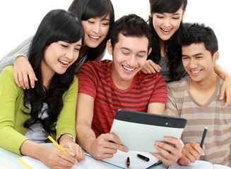 Friendly group of students with tablet pc