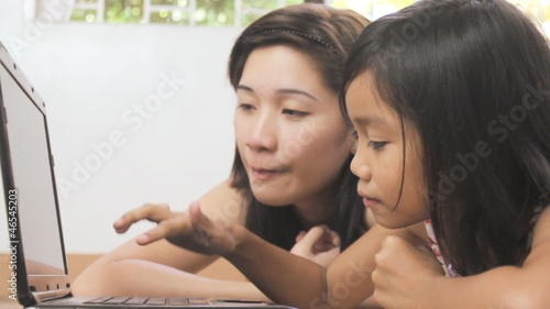 Young girl learning how to use a computer