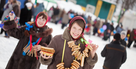 Girl  with pancake during  Maslenitsa festival