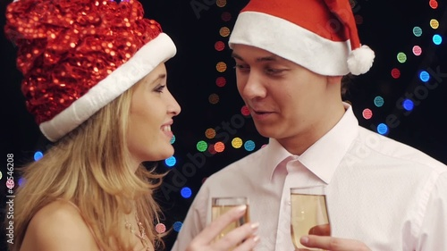 Happy attractive couple have conversation  at new year party