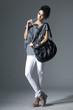 Portrait of young beautiful women with her handbag Posing