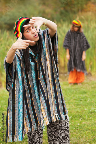 Young rastafarian people in autumn park