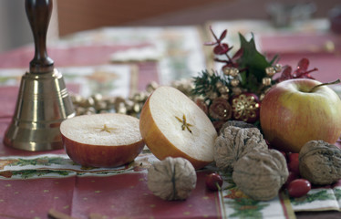 Christmas still life, bell, apples and walnuts