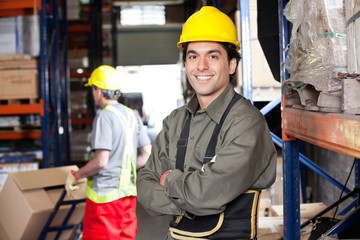 Young Foreman With Arms Crossed At Warehouse