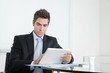 Young Businessman With Digital Tablet And Coffee Cup