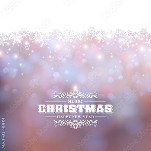 holiday background with defocused lights and snowflakes