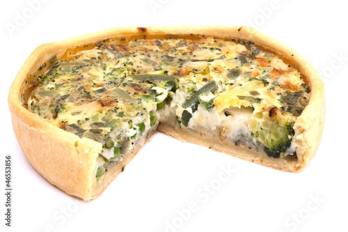 Vegetable quiche on white background