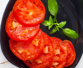 Fresh tomato with green aroma basil