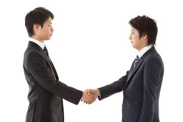 young businessmen handshake