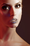 Luxury woman with rhinestones on her lips poster