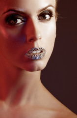 Luxury woman with rhinestones on her lips