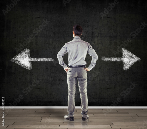 young business man in front of a blackboard