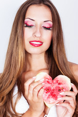 beautiful woman holding the heart from watermelon