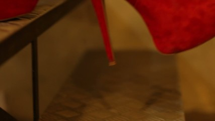 Red shoes descending stairs