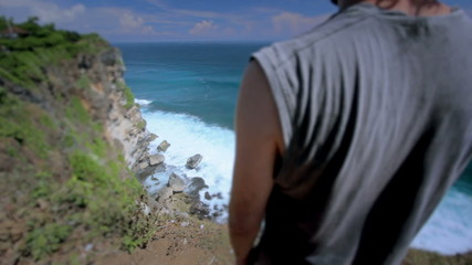 suicidal young man at the edge of cliff