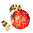 Red Christmas ball with a gold ribbon on a white background