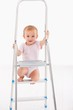 Happy baby girl on ladder