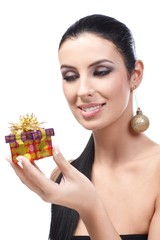 Attractive woman receiving Christmas present