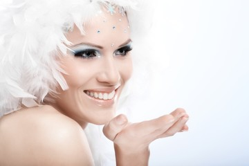 Winter portrait of beautiful young woman smiling