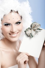 Beautiful woman smiling with fancy present