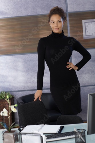 Attractive businesswoman at desk