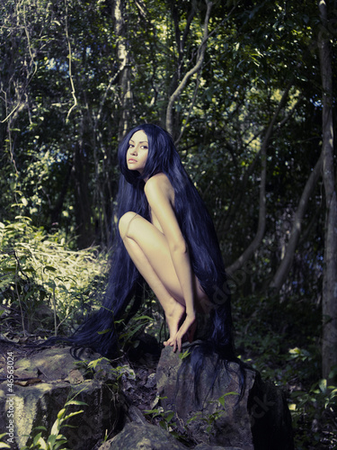 Beautiful nude lady in the rainforest