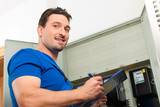 Technician reading the electricity meter