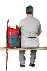 Man with backpack sitting on the bench
