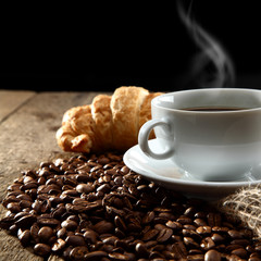 aromatic coffee with croissant