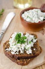 pate of cottage cheese with herbs and chili peppers on a piece o
