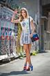 fashion urban portrait of beautiful model with sun glasses