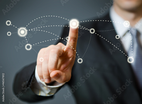 Businessman pressing a spot in the air