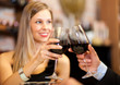 Couple toasting red wine