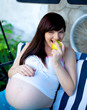 portrait of pretty young woman expecting a baby,outdoors,