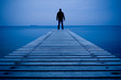Man standing on a wooden pier