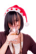 Woman with Santa cap drinking wine
