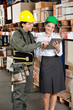 Supervisor And Foreman Using Digital Tablet at Warehouse