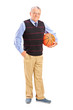 Full length portrait of a gentleman holding a basketball