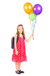 Full length portrait of a girl holding a bunch of balloons