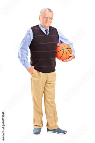Full length portrait of a gentleman holding a basketball