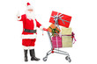 Santa Claus holding a cart full of gifts and giving a thumb up