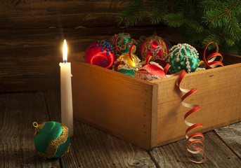 Vintage handmade Christmas decorations in wooden box.