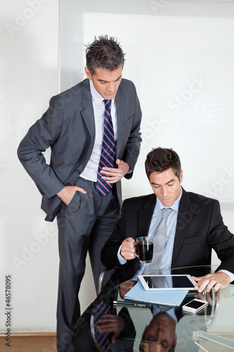 Businessman With Digital Tablet In A Meeting With Colleague