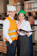 Two Young Supervisors At Warehouse